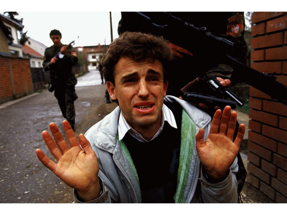 Blood and Honey: A Balkan War Journal A Muslim in Bijelina, Bosnia begs for his life after capture by Arkan's Tigers in the Spring of 1992.  ronhaviv.com