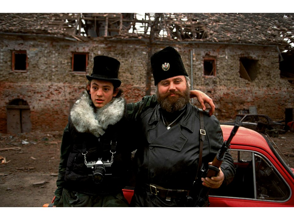 Blood and Honey: A Balkan War Journal Serbian father and son pose on newly captured territory. Fall 1991. ronhaviv.com